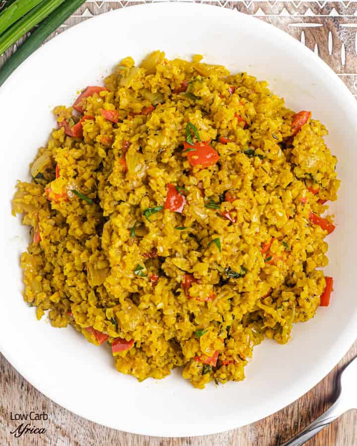 cauliflower rice made with scallions and red bell peppers