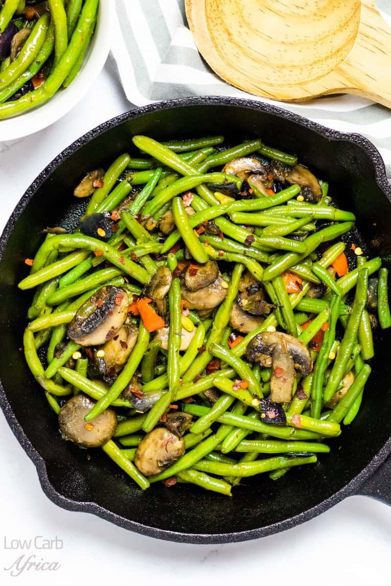 sauteed green beans and mushrooms on a skillet