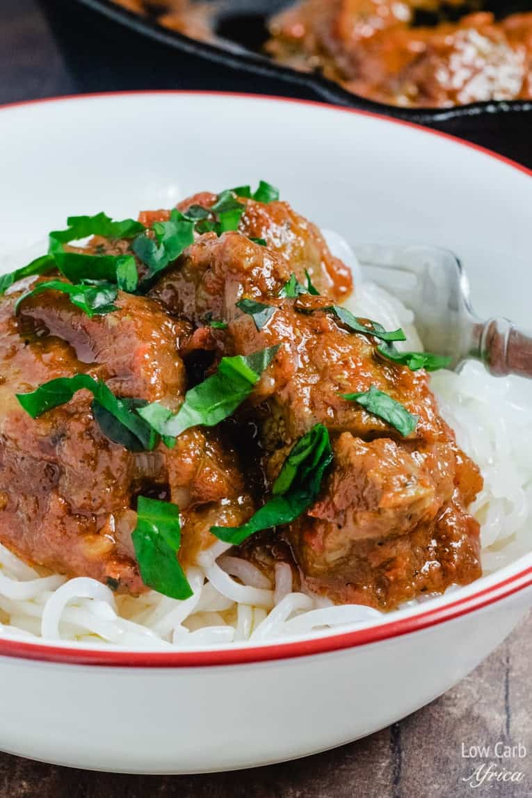 nigerian beef stew served over shirataki noodles