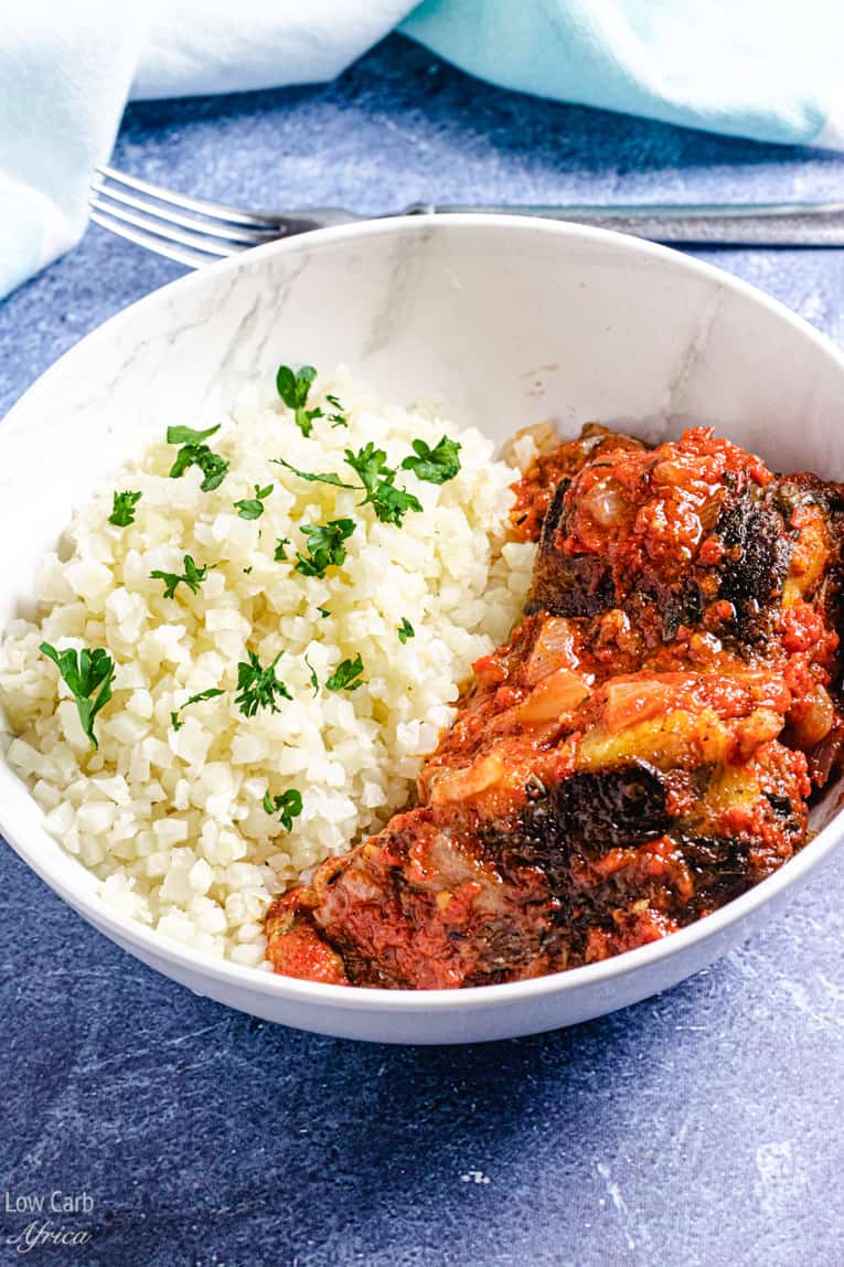 bowl of African fish stew with cauliflower rice