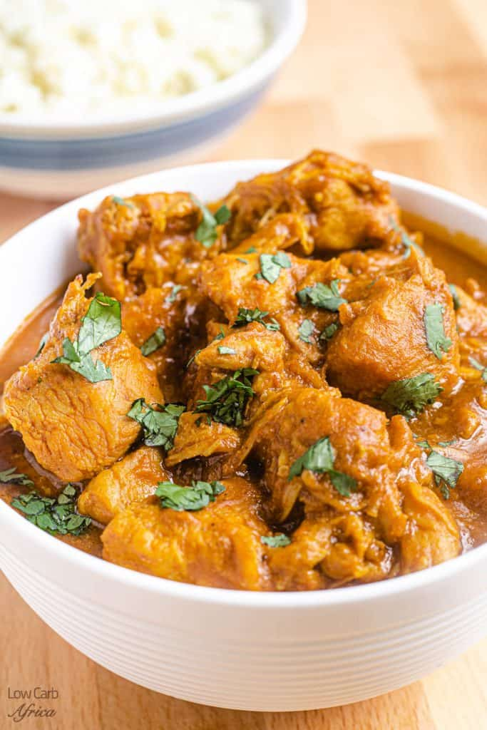 image of chicken curry on a plate with cilantro