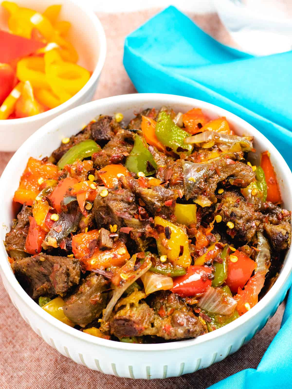 peppered goat meat with red and green bell peppers