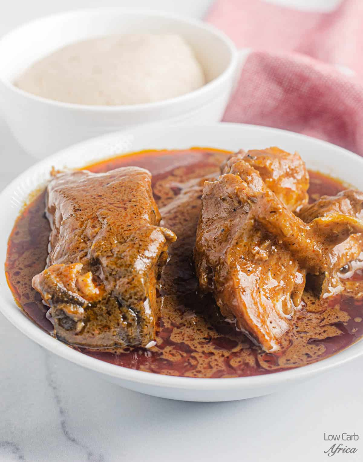 bowl of low carb fufu and palm nut soup