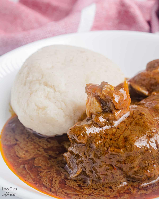 bowl of low carb fufu and banga soup