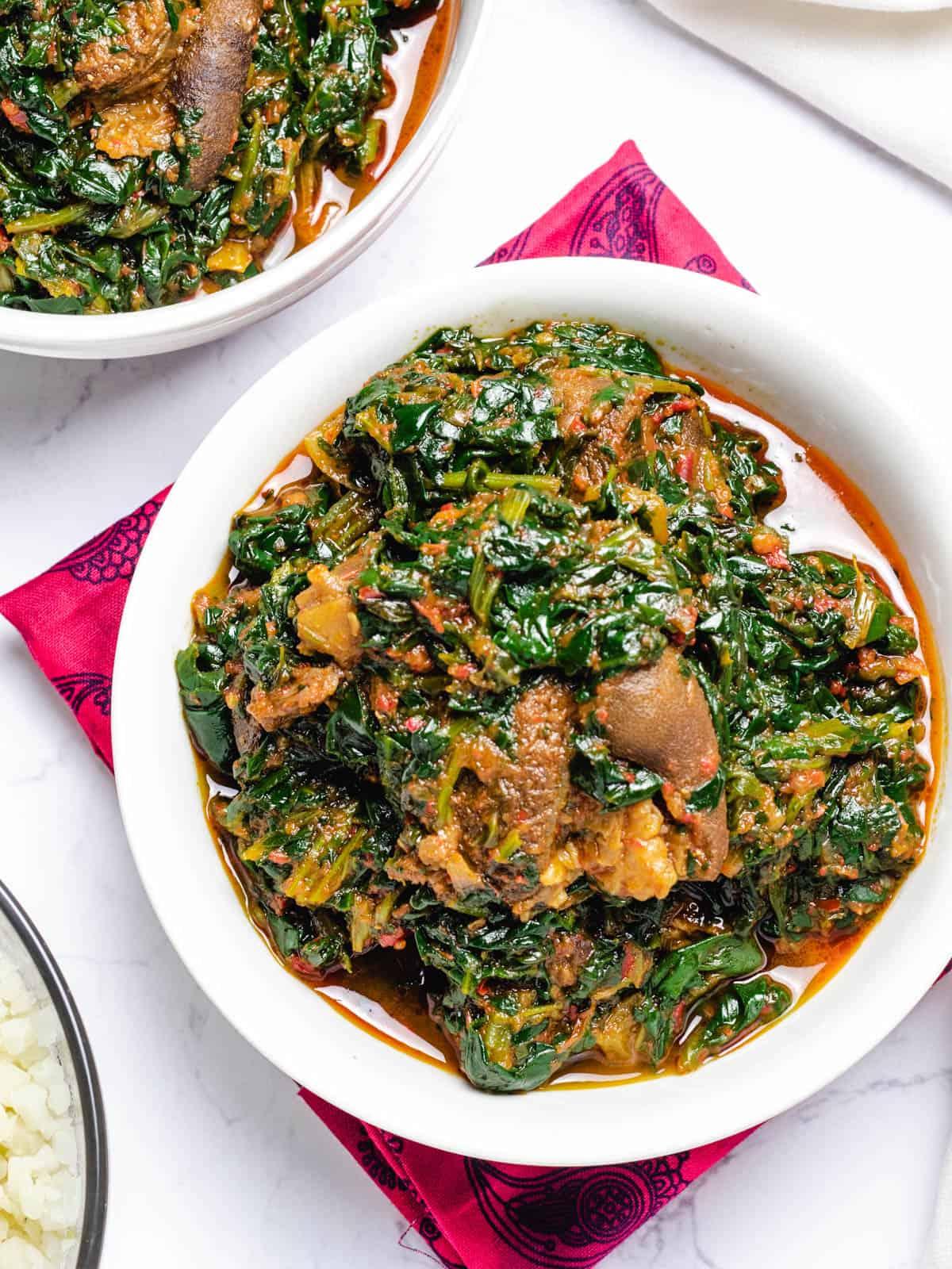 nigerian spinach stew in a white bowl