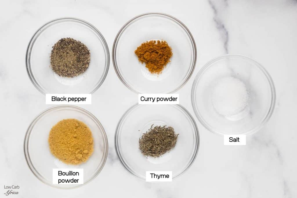 small sized bowls of bouillon powder, thyme, black pepper