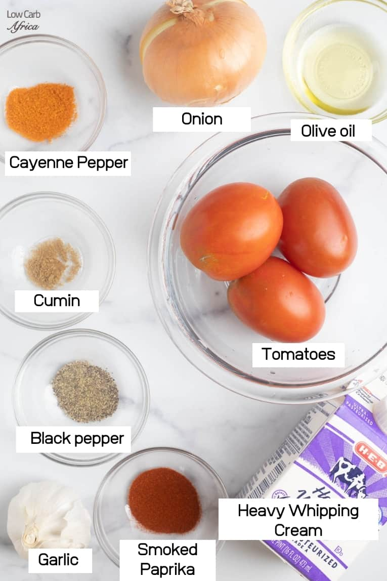 ingredient list of tomatoes, heavy whipping cream and spices