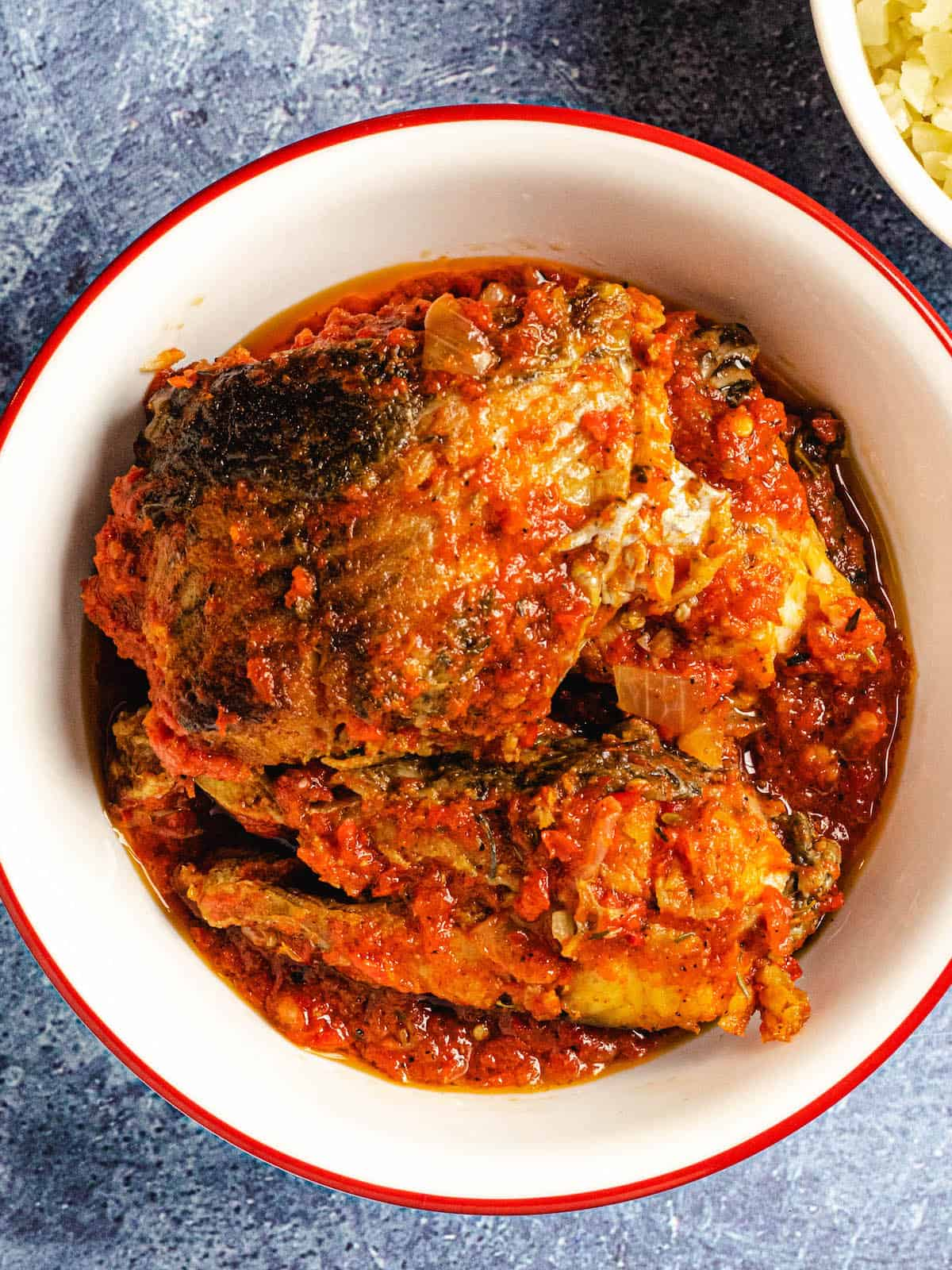 African fish stew in white bowl