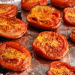 several pieces of roasted tomatoes on foil lined tray