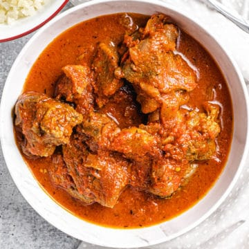 African goat stew served on a white plate