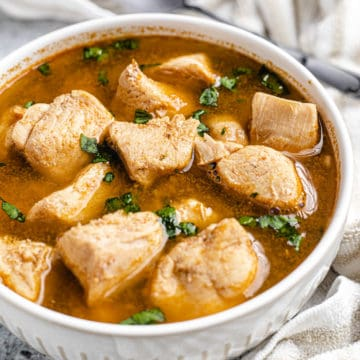 nigerian chicken pepper soup on a white bowl