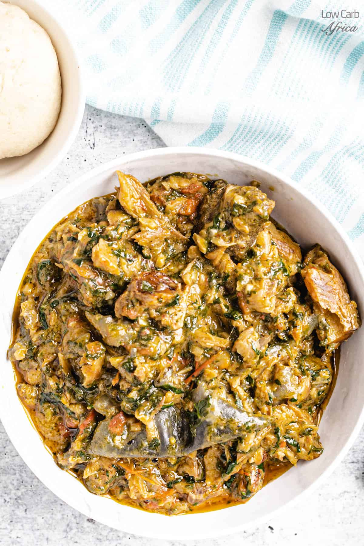 Fumbwa spinach stew on a white plate