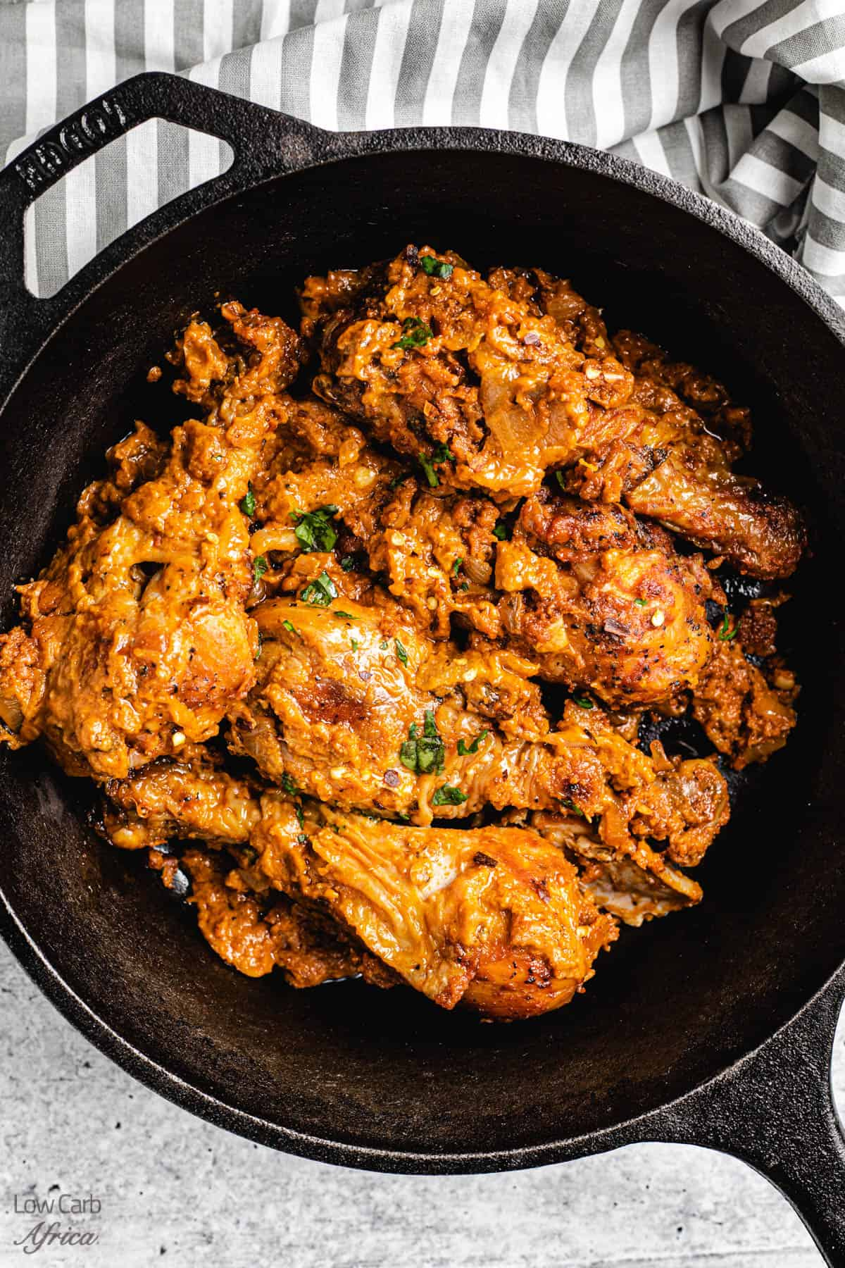 moambe chicken in a large skillet