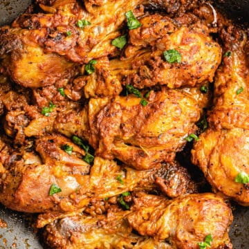 congolese moambe chicken in a skillet