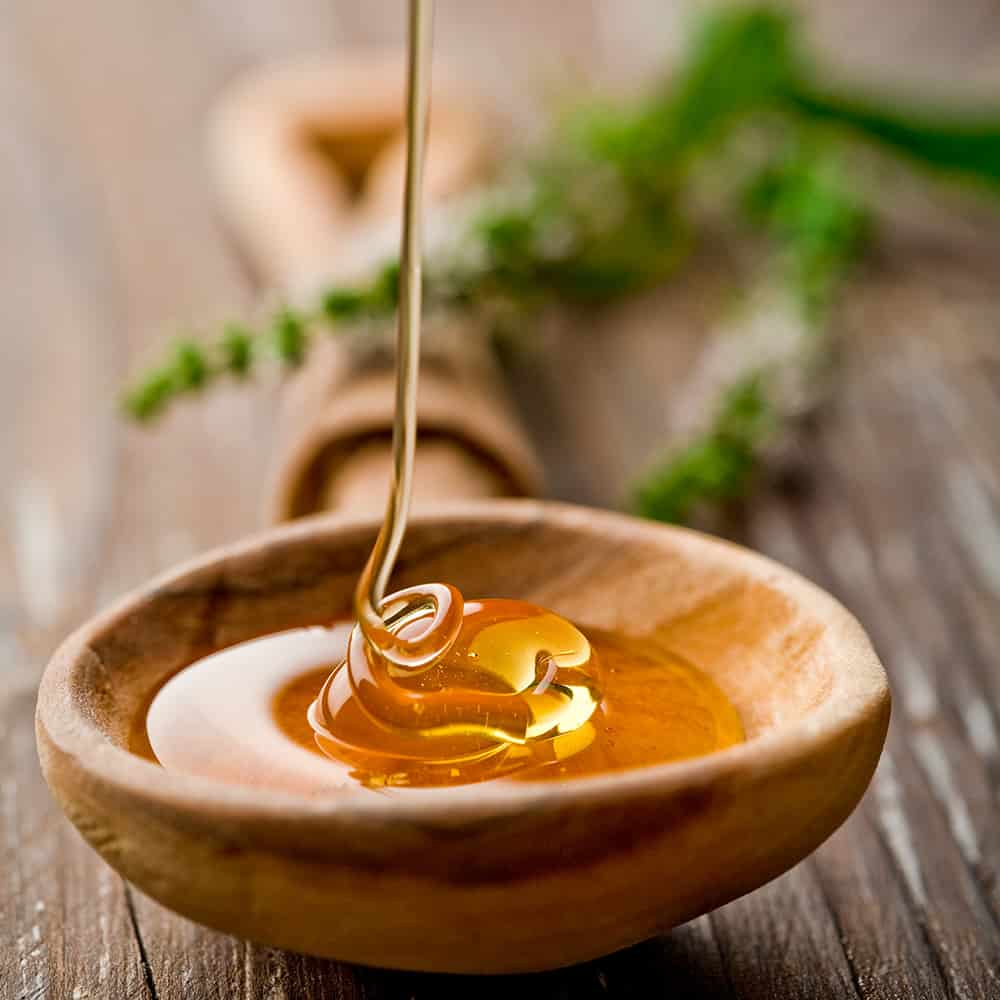 picture of honey drizzling into a bowl