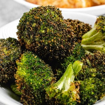 roasted broccoli in white plate